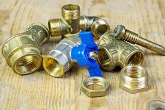 Water tap and fittings for water supply. Plumbing fixtures and piping parts. Sanitary and technical works Royalty Free Stock Photos