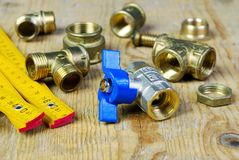 Water tap and fittings for water supply. Plumbing fixtures and piping parts. Sanitary and technical works Royalty Free Stock Image