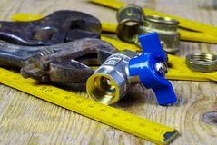 Water tap fittings for water supply. Sanitary and technical works Stock Image
