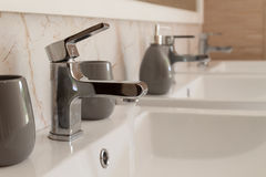Water tap with flowing water. Royalty Free Stock Images
