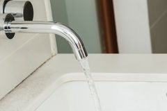 Water tap with flowing water Royalty Free Stock Photos