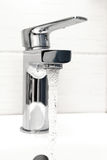Water tap with flowing water Stock Photo