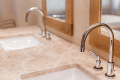 Water tap and marble sink Stock Images