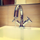 Water tap with modern design in bathroom Royalty Free Stock Photos