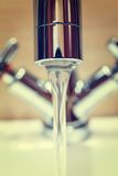 Water tap with modern design in bathroom Stock Image