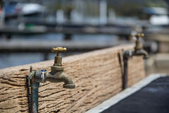 Water tap. Old water tap at fish cleaning station Royalty Free Stock Photography