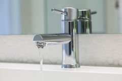 Water Tap. A water pouring faucet with clean surface Stock Images