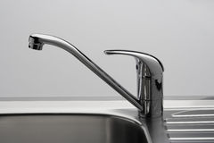 Water tap and sink in grey. Water tap and sink in a modern kitchen stock photo