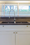 Water tap and sink in kitchen Stock Image