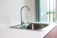Water tap and sink. In a modern kitchen Stock Images