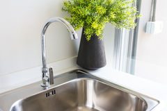 Water tap with sink. In  modern kitchen Stock Images