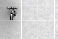 Water Tap on tiles Stock Photos