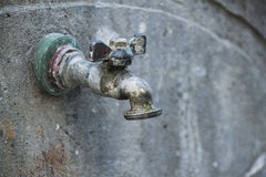 Water tap on the wall Royalty Free Stock Images