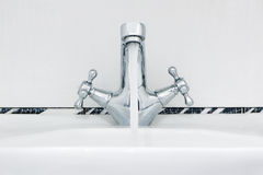Water tap with a water stream. Royalty Free Stock Image
