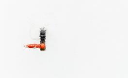 Water tap on white concrete wall. Orange-black water tap on white concrete wall Royalty Free Stock Photos
