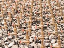 Water taps of fountain court, closeup among gravel. Stock Photos