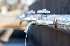 Water taps in a park Stock Image