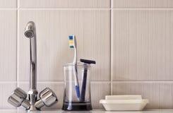 Water taps Toothbrush Razor Royalty Free Stock Photos