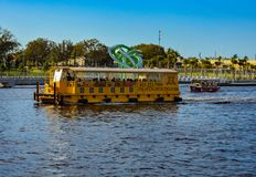 Water tax and nice boat sailing on Hillsborough river in downtown area . stock photography