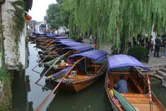 Water taxi assembly and waiting for customers beside a river in Zhou Zhuang, China. This picture was taken in Zhou Zhuang, a water town in China Royalty Free Stock Photos