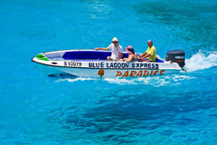 Water Taxi at Blue Lagoon. High speed boat called Blue Lagoon Express at turquoise water near Malta coastline Stock Photo