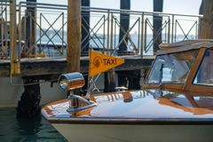 A water taxi boat on the Grand Canal in Venice. Close-up Stock Photo