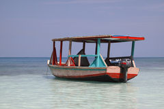 Water taxi boat in paradise. Sitting on tropical blue waters of the Caribbean royalty free stock photos