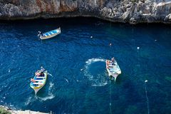 Water taxi boats in the bay, Glue Grotto. Elevated view of traditional Dghajsa water taxi boats at the departure point in the bay, Blue Grotto, Malta, Europe Royalty Free Stock Photography