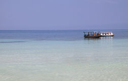 Water taxi boats on blue ocean Stock Images