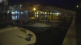 Water taxi boats docked at night mooring, passenger transportation in Venice. Stock footage stock footage
