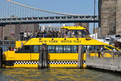 Water Taxi at the Brooklyn Bridge in New York City Royalty Free Stock Photos