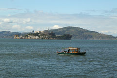 Water taxi in the front of Alcatraz island in San Francisco Bay Royalty Free Stock Photography