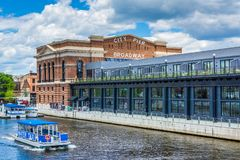 A water taxi and the historic Recreation Pier in Fells Point, Baltimore, Maryland.  stock images