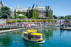 A water taxi in the Inner Harbour of Victoria. Water taxis provide reliable service to various locations around the waterfront of Victoria, British Columbia Royalty Free Stock Photo
