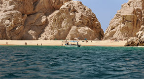 Water taxi at Lovers Beach Cabo San Lucas. Attempting a landing. Lovers Beach has access to Sea of Cortez and also to the Pacific Ocean. That side is less Royalty Free Stock Image