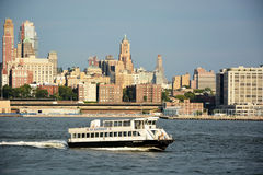 Water taxi passes the Hudson bay Stock Images