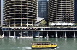 Water Taxi. This is a Summer picture of a water taxi traveling East on the Chicago River located in Chicago, Illinois in Cook County.  The background features a Royalty Free Stock Image