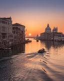 Water taxi at sunrise on Grand Canal in Venice Royalty Free Stock Photography