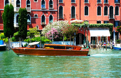 The water taxi with tourists is on Grand Canal Stock Photos