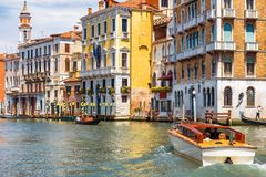 Water taxi sails along the Grand Canal in Venice, Italy Royalty Free Stock Images