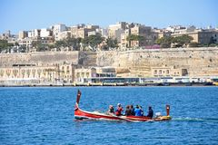 Water taxi and Valletta waterfront, Malta. Royalty Free Stock Photo