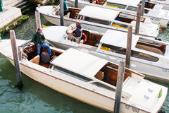 Water taxis in canal of Venice city Royalty Free Stock Images