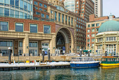 Water taxis inside historic rowes wharf in boston Royalty Free Stock Images
