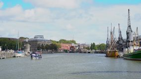 Water taxis and The Matthew sailing ship and M Shed in Bristol Docks, Bristol