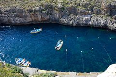 Water Taxis moored in the bay, Blue Grotto. Elevated view of traditional Dghajsa water taxi boats at the departure point in the bay, Blue Grotto, Malta, Europe Royalty Free Stock Photography