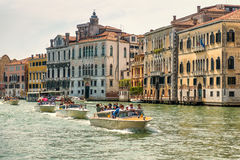 Water taxis are sailing along the Grand Canal in Venice Stock Images