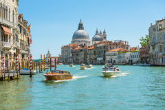 Water taxis are sailing along the Grand Canal in Venice Royalty Free Stock Photo