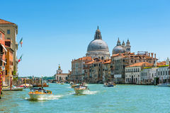 Water taxis are sailing along the Grand Canal in Venice Royalty Free Stock Photography