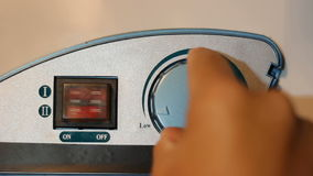 Water temperature controls on a hot water heater, twist hand. The Water temperature controls on a hot water heater, twist hand stock footage