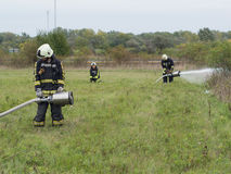 Water test on the green grass. SZEGED, HUNGARY - October 8, 2015: Regional fire-fighting exercise in the training area with urban and contract firefighters Stock Photography